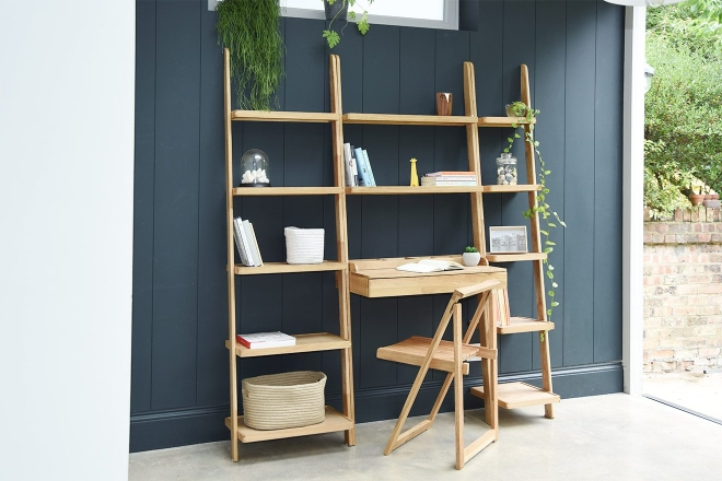 Leaning Ladder Shelves Set Against Dark Wall